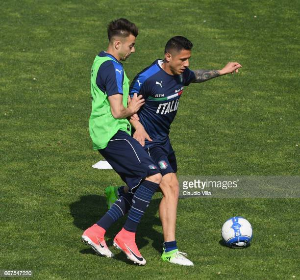 Stephan El Shaarawy and Gianluca Lapadula of Italy compete for the ball during the training session at the club's training ground at Coverciano on...