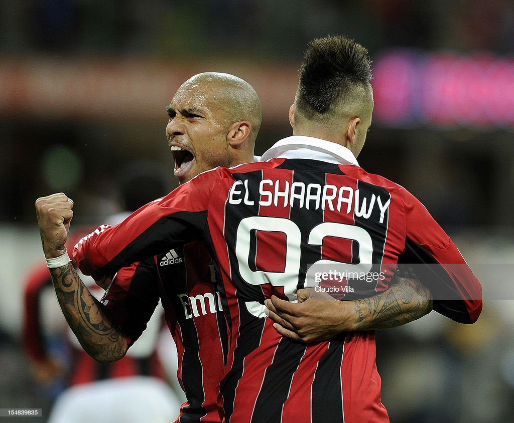 Stephan El Shaarawy and Nigel De Jong of AC Milan celebrate scoring the first goal during the Serie A match between AC Milan and Genoa CFC at San...