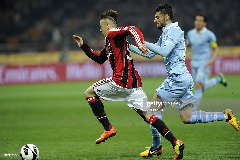 Stephan El Shaarawy of AC Milan (L) and Antonio Candreva of S.S. Lazio compete for the ball during the Serie A match between AC Milan and S.S. Lazio at San Siro Stadium on March 2, 2013 in Milan, Italy.