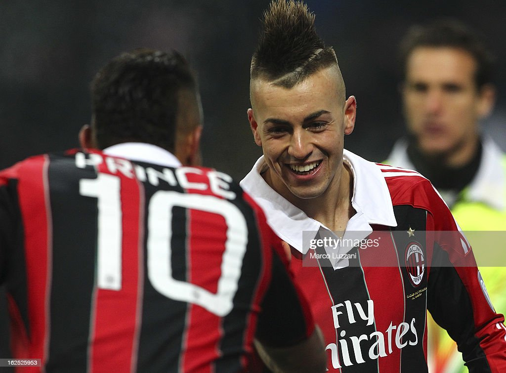 Stephan El Shaarawy (R) of AC Milan celebrates after scoring the opening goal his team-mate Kevin-Prince Boateng (L) during the Serie A match FC Internazionale Milano and AC Milan at San Siro Stadium on February 24, 2013 in Milan, Italy.