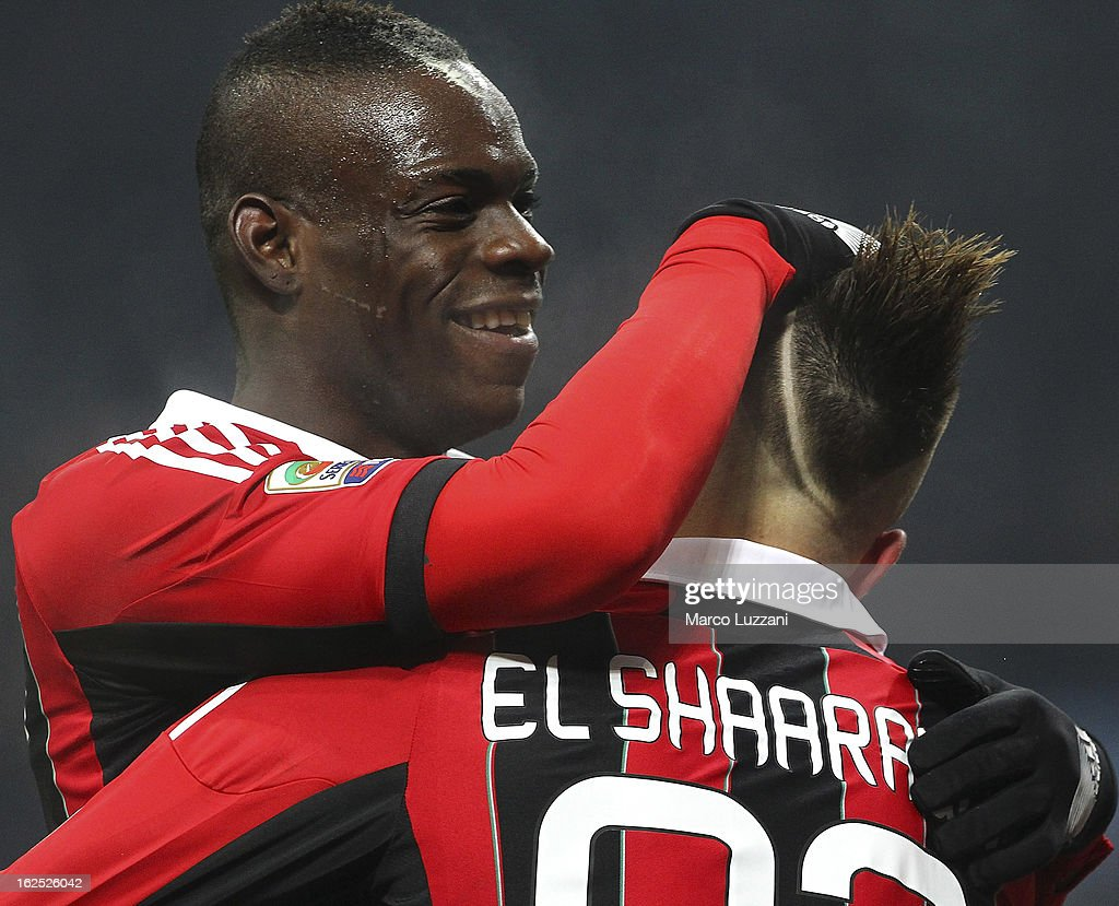 Stephan El Shaarawy (R) of AC Milan celebrates after scoring the opening goal his team-mate Mario Balotelli (L) during the Serie A match FC Internazionale Milano and AC Milan at San Siro Stadium on February 24, 2013 in Milan, Italy.