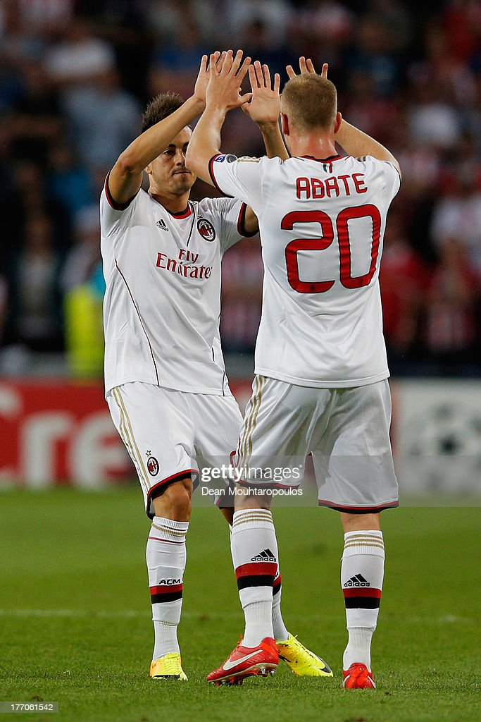 Stephan El Shaarawy (L) of AC Milan celebrates scoring the first goal of the match with team mates Ignazio Abate during the UEFA Champions League Play-off First Leg match between PSV Eindhoven and AC Milan at PSV Stadion on August 20, 2013 in Eindhoven, Netherlands.