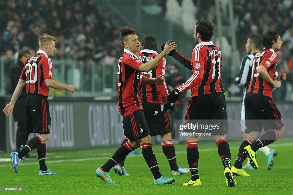 Stephan El Shaarawy (C) of AC Milan celebrates the opening goal with team-mates Giampaolo Pazzini during the TIM cup match between Juventus FC and AC Milan at Juventus Arena on January 9, 2013 in Turin, Italy.