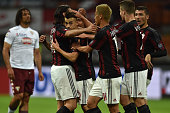 Stephan El Shaarawy of AC Milan celebrates the opening goal with team mates during the Serie A match between AC Milan and Torino FC at Stadio...