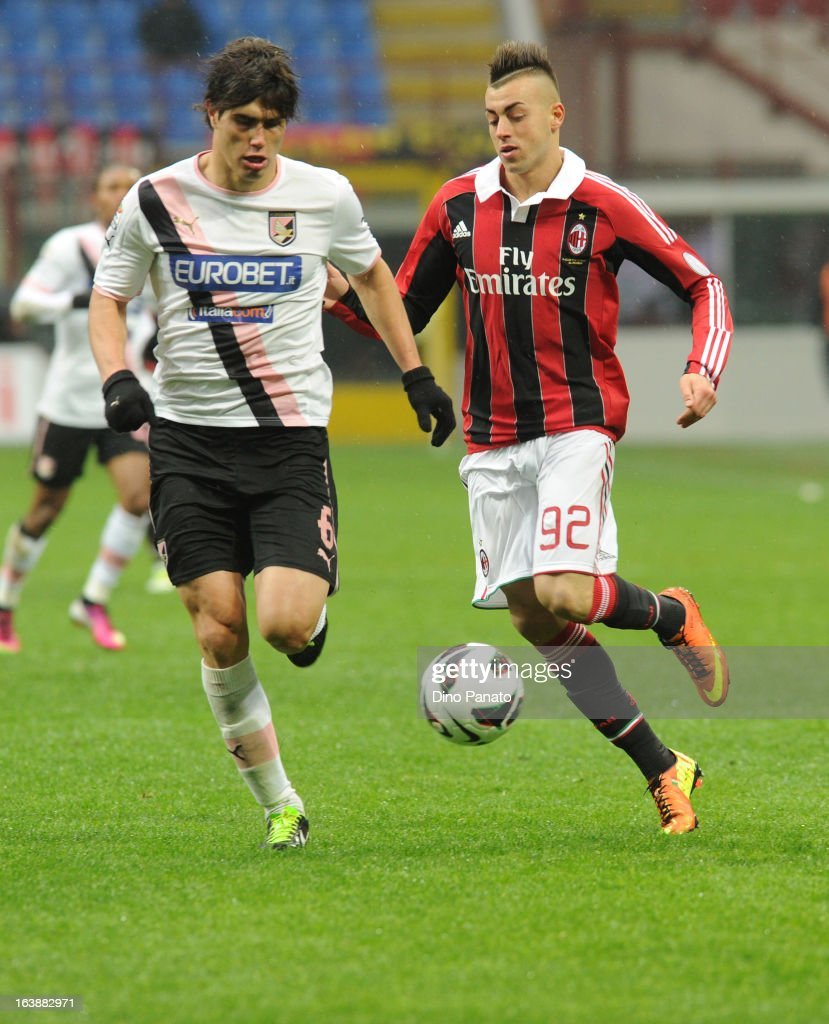 Stephan El Shaarawy (R) of AC Milan competes with Ezequiel Munoz of US Citta di Palermo during the Serie A match between AC Milan and US Citta di Palermo at San Siro Stadium on March 17, 2013 in Milan, Italy.