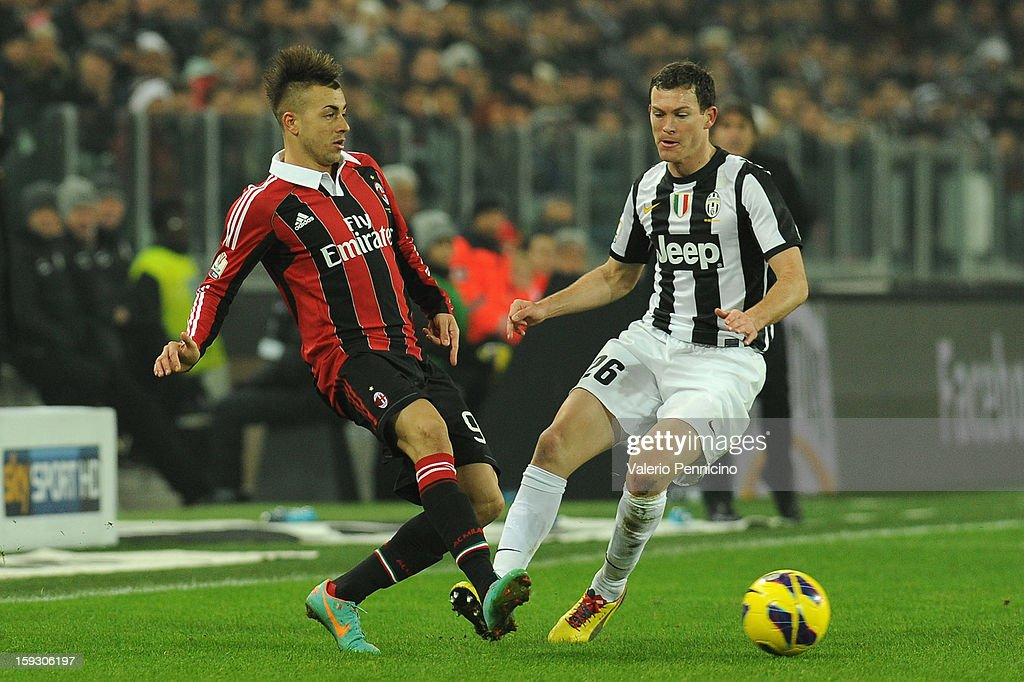 Stephan El Shaarawy (L) of AC Milan in action against Stephan Lichtsteiner of Juventus FC during the TIM cup match between Juventus FC and AC Milan at Juventus Arena on January 9, 2013 in Turin, Italy.
