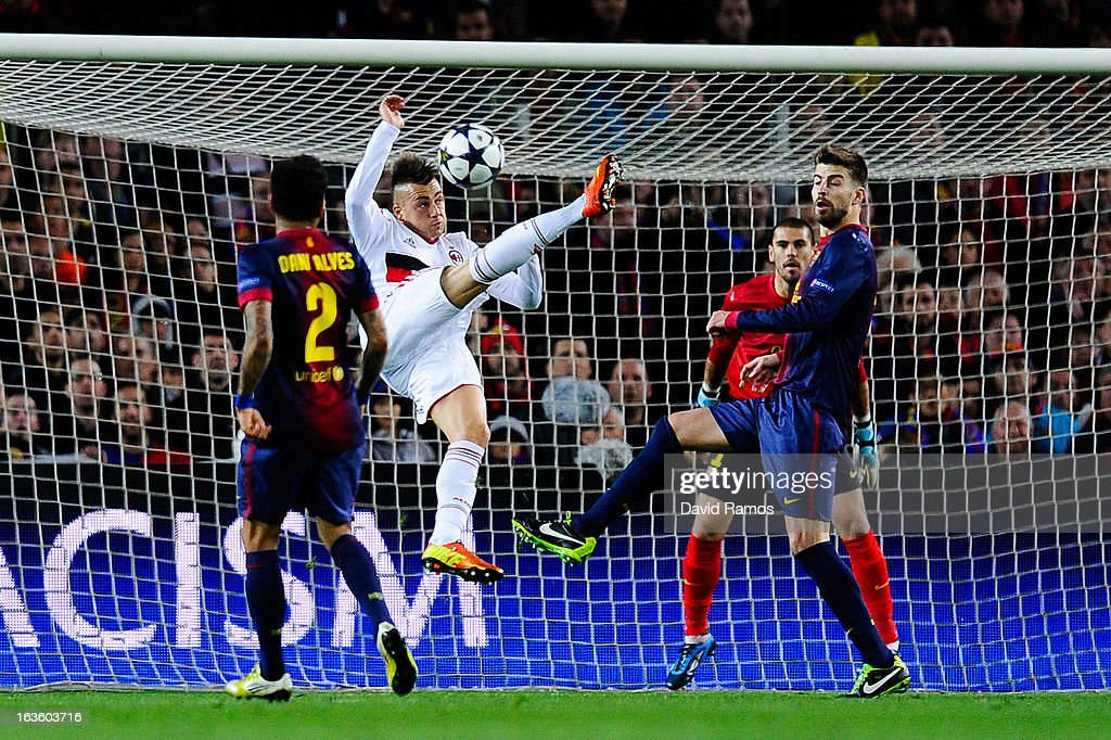 Stephan El Shaarawy of AC Milan performs an overhead kick under a challenge from Dani Alves (L) and Gerard Pique of FC Barcelona during the UEFA Champions League round of 16 second leg match between FC Barcelona and AC Milan at the Camp Nou Stadium on March 12, 2013 in Barcelona, Spain. FC Barcelona won 4-0.