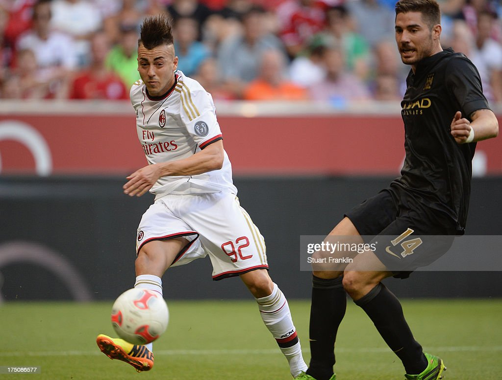<a gi-track='captionPersonalityLinkClicked' href=/galleries/search?phrase=Stephan+El+Shaarawy&family=editorial&specificpeople=7181554 ng-click='$event.stopPropagation()'>Stephan El Shaarawy</a> of AC Milan scores a goal during the Audi Cup semi-final between Manchester City and AC Milan at Allianz Arena on July 31, 2013 in Munich, Germany.