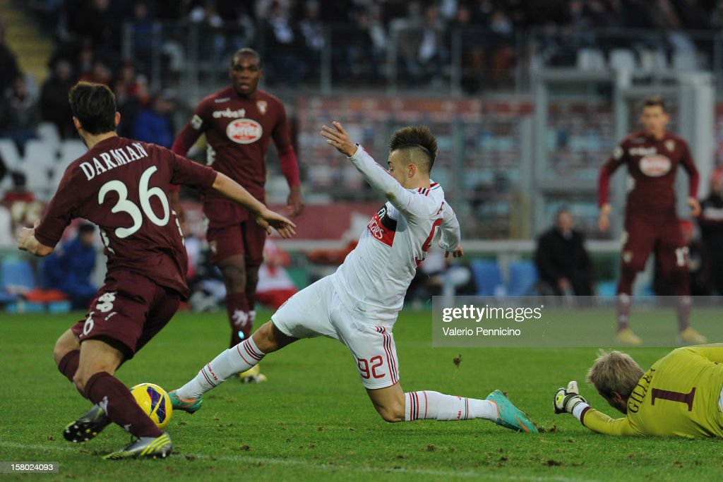 <a gi-track='captionPersonalityLinkClicked' href=/galleries/search?phrase=Stephan+El+Shaarawy&family=editorial&specificpeople=7181554 ng-click='$event.stopPropagation()'>Stephan El Shaarawy</a> (C) of AC Milan scores their fourth goal during the Serie A match between Torino FC and AC Milan at Stadio Olimpico di Torino on December 9, 2012 in Turin, Italy.