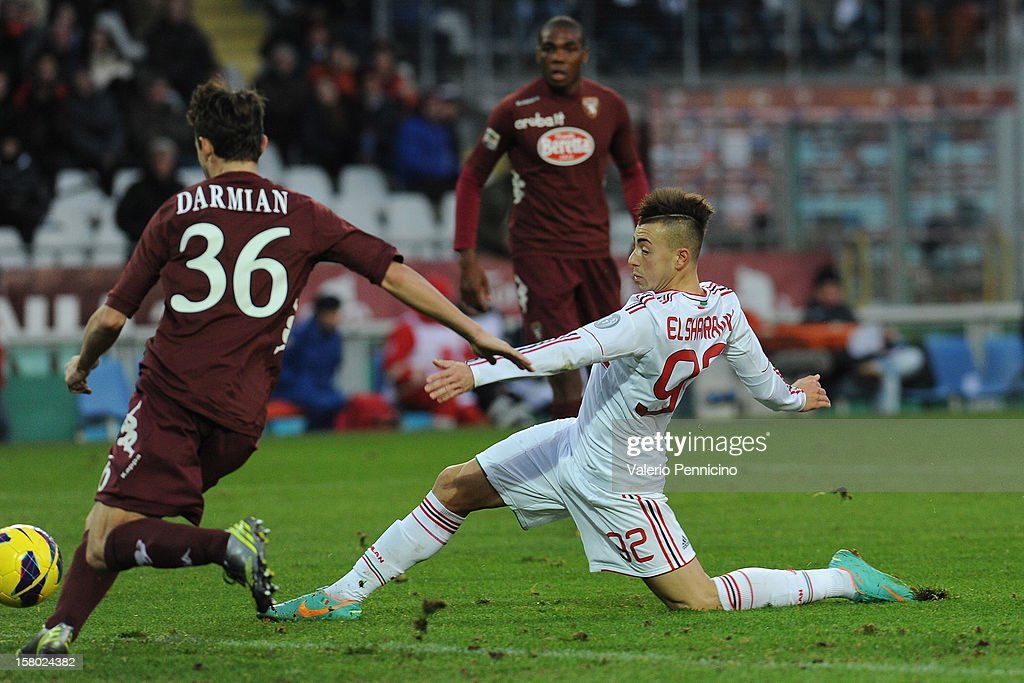 <a gi-track='captionPersonalityLinkClicked' href=/galleries/search?phrase=Stephan+El+Shaarawy&family=editorial&specificpeople=7181554 ng-click='$event.stopPropagation()'>Stephan El Shaarawy</a> (R) of AC Milan scores their fourth goal during the Serie A match between Torino FC and AC Milan at Stadio Olimpico di Torino on December 9, 2012 in Turin, Italy.