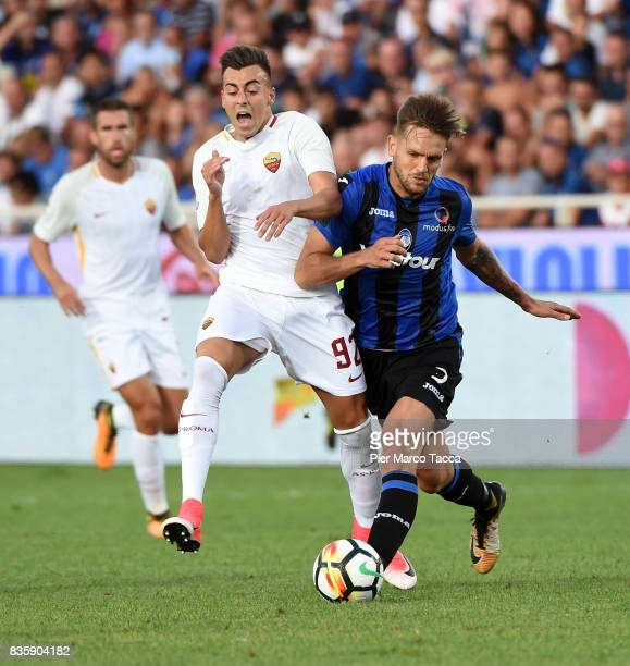 Stephan El Shaarawy of AS Roma competes for the ball with Rafael Toloi of Atalanta BC during the Serie A match between Atalanta BC and AS Roma at...