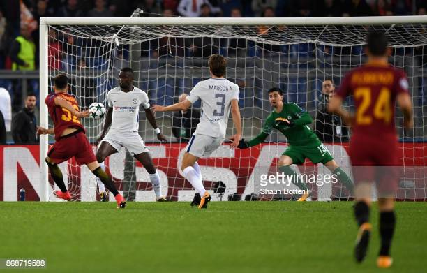 Stephan El Shaarawy of AS Roma scores his sides first goal during behind Thibaut Courtois of Chelsea the UEFA Champions League group C match between...