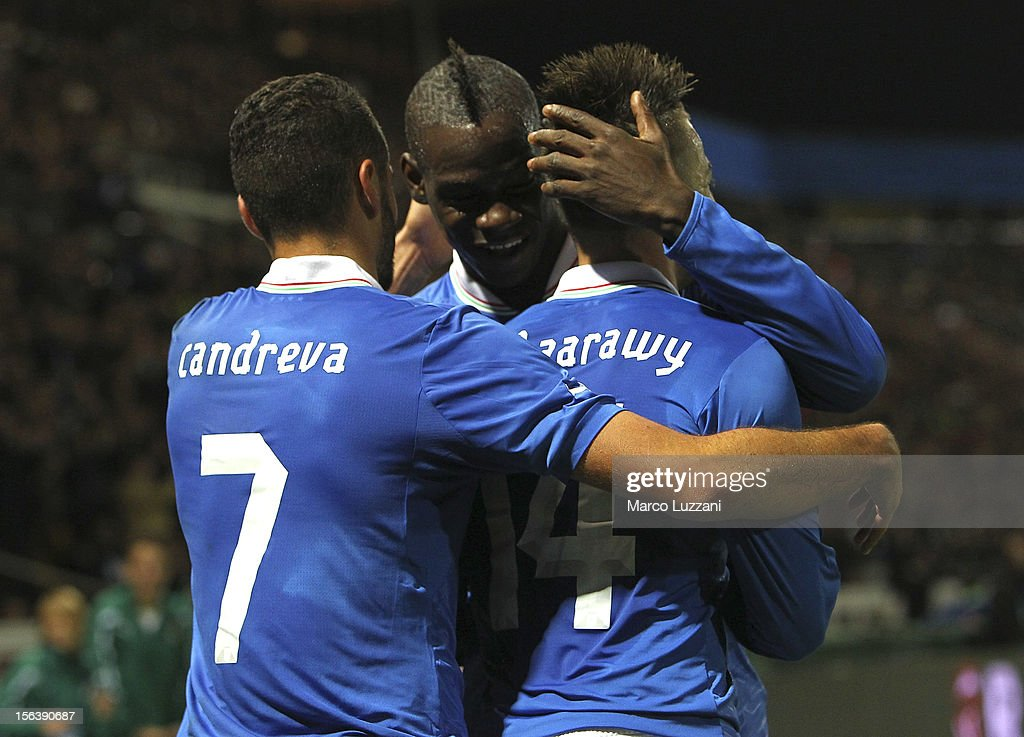 Stephan El Shaarawy (R) of Italy celebrates with his team-mates Mario Balotelli (C) and Antonio Candreva (L) after scoring the opening goal during the international friendly match between Italy and France at Stadio Ennio Tardini on November 14, 2012 in Parma, Italy.