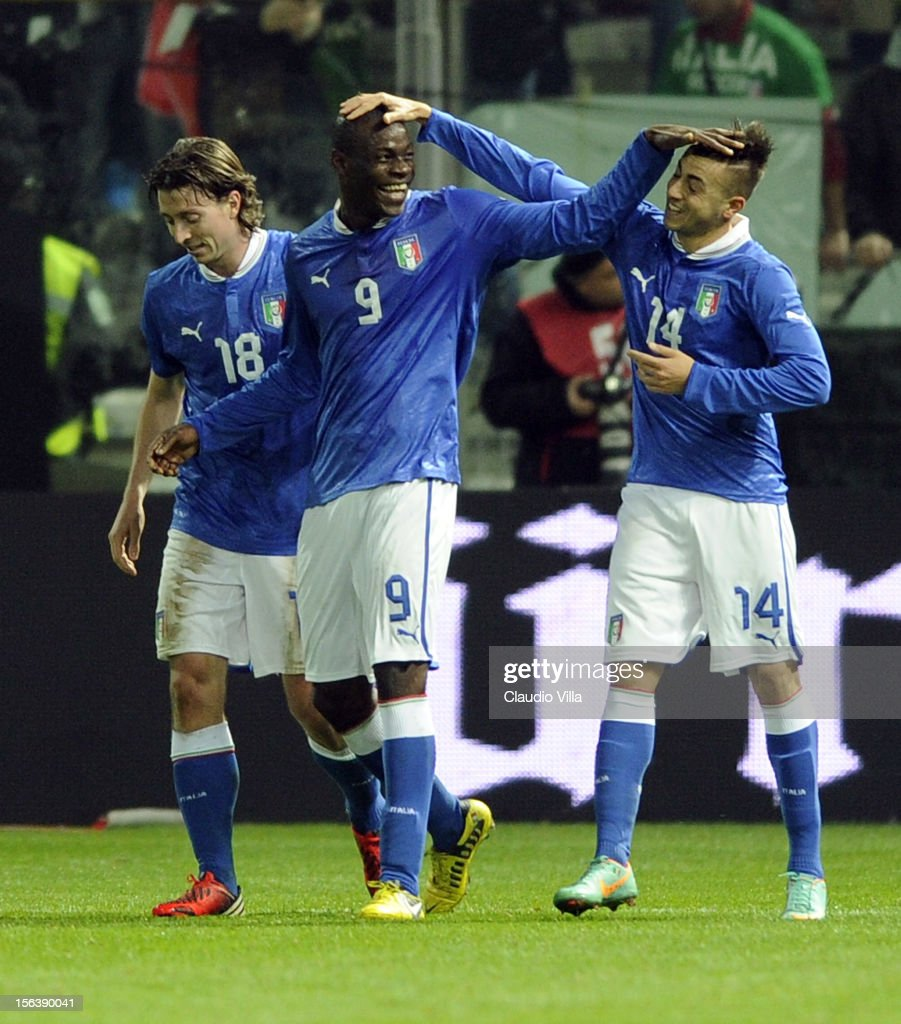 Stephan El Shaarawy (R) of Italy celebrates with team-mates Riccardo Montolivo (L) and Mario Balotelli (C) after scoring the opening goal during the international friendly match between Italy and France at Stadio Ennio Tardini on November 14, 2012 in Parma, Italy.