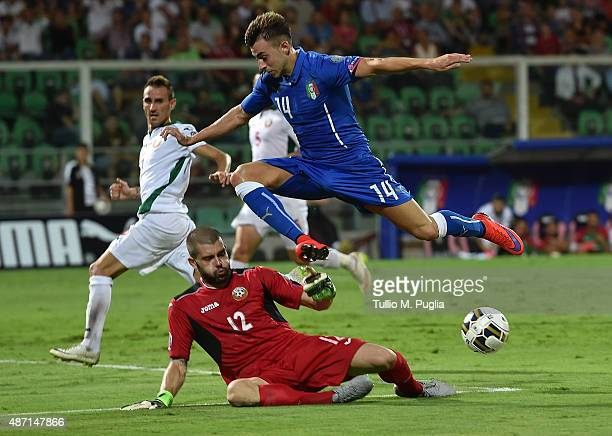 Stephan El Shaarawy of Italy jumps af Bozhidar Mitrev of Bulgaria tackles during the UEFA EURO 2016 Qualifier match between Italy and Bulgaria on...