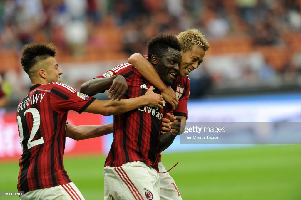 <a gi-track='captionPersonalityLinkClicked' href=/galleries/search?phrase=Stephan+El+Shaarawy&family=editorial&specificpeople=7181554 ng-click='$event.stopPropagation()'>Stephan El Shaarawy</a>, Sulley Ali Muntari and Keisuke Honda of AC Milan celebrate the goal of 2-0 during the Serie A match between AC Milan and SS Lazio at Stadio Giuseppe Meazza on August 31, 2014 in Milan, Italy.