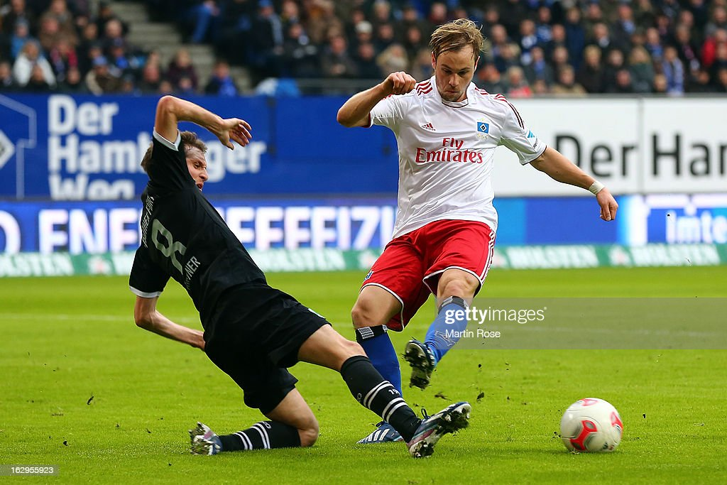 Stephan Fuerstner (l) of Greuther Fuerth challenges Maximilian Beister of Hamburger SV during the Bundesliga match between Hamburger SV and Greuther Fuert at Imtech Arena on March 2, 2013 in Hamburg, Germany.