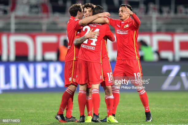 Stephan Fuerstner Steven Skrzybski Philipp Hosiner and Kenny Prince Redondo of 1 FC Union Berlin celebrate the 10 win after the game between 1 FC...
