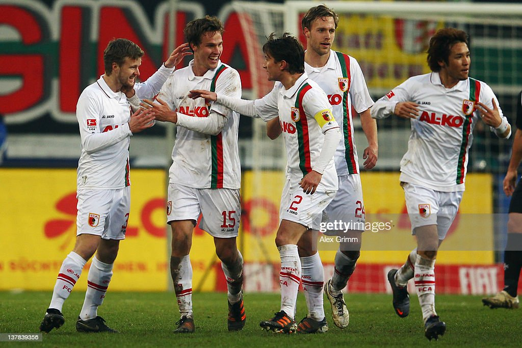 Stephan Hain of Augsburg celebrates his team's second goal with team mates during the Bundesliga match between FC Augsburg and 1 FC Kaiserslautern at...