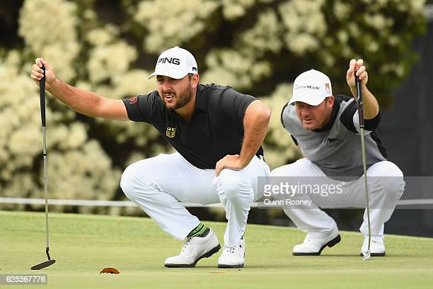 Stephan Jaeger and Alex Cejka of Germany line up a putt during day one of the World Cup of Golf at Kingston Heath Golf Club on November 24 2016 in...