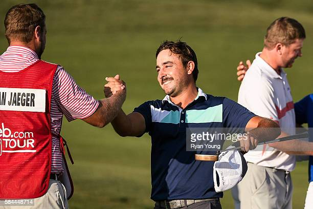 Stephan Jaeger is congratulated by his caddy after shooting a 58 during the first round of the Webcom Tour Ellie Mae Classic at TPC Stonebrae on July...