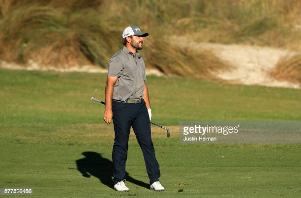 Stephan Jaeger of Germany reacts after playing his second shot on the 18th hole during the final round of The RSM Classic at Sea Island Golf Club...