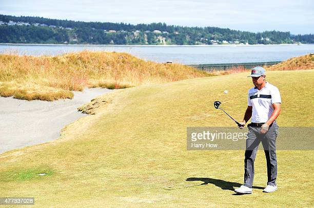 Stephan Jaeger of Germany walks across a green during a practice round prior to the start of the 115th US Open Championship at Chambers Bay on June...