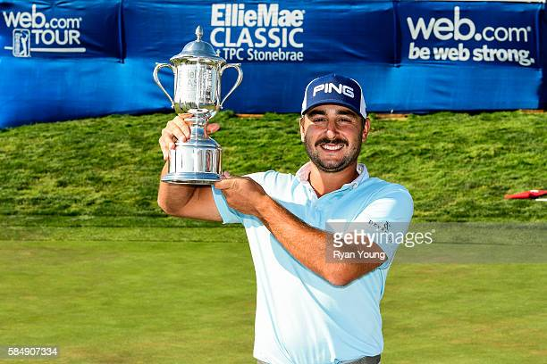Stephan Jaeger poses for with the trophy following his victory during the final round of the Webcom Tour Ellie Mae Classic at TPC Stonebrae on July...