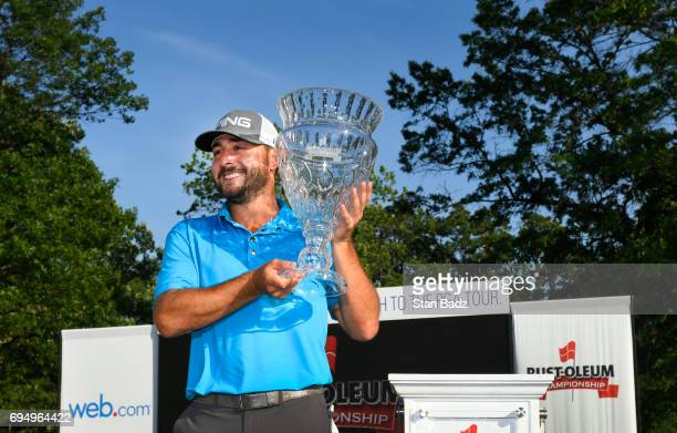 Stephan Jaeger poses with the winner's trophy after the final round of the Webcom Tour RustOleum Championship at Ivanhoe Club on June 11 2017 in...
