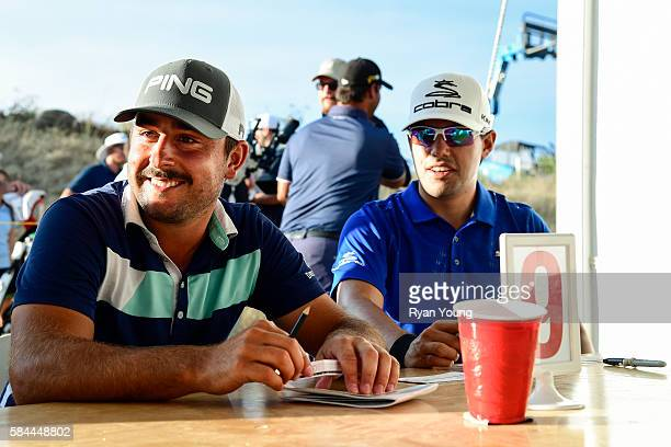 Stephan Jaeger smiles as he signs his card following his opening round 58 during the first round of the Webcom Tour Ellie Mae Classic at TPC...