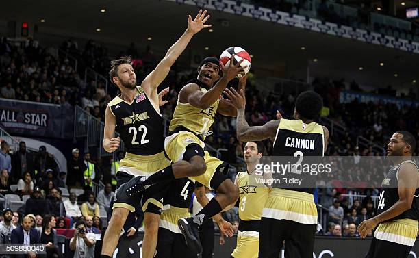 Stephan James of Team Canada shoots the ball as Joel David Moore and Nick Cannon or Team USA defend during the NBA AllStar Celebrity Game at the...