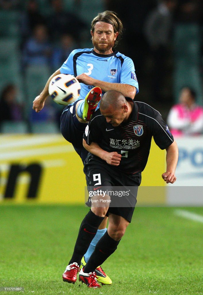 Stephan Keller of Sydney competes for the ball against Salmeron of Shanghai during the group H ACF Champions League match between Sydney FC and...