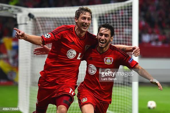 Stephan Kiessling of Bayer Leverkusen celebrates scoring the opening goal with Hakan Calhanoglu of Bayer Leverkusen during the UEFA Champions League...