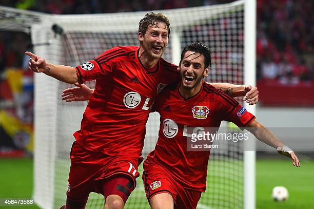 Stephan Kiessling of Bayer Leverkusen celebrates scoring the opening goal with Hakan Calhanoglu of Bayer Leverkusen during the UEFA Champions League...