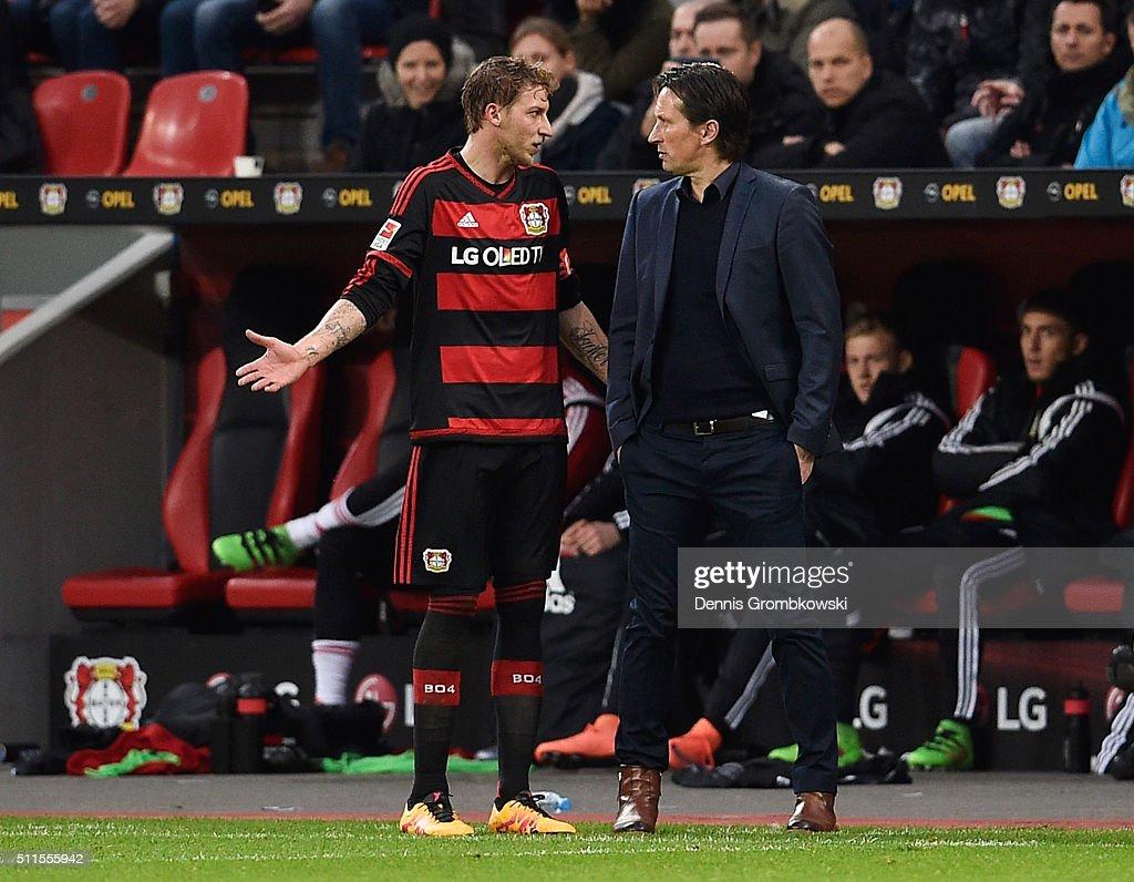Stephan Kiessling of Bayer Leverkusen in discussion with Roger Schmidt head coach of Bayer Leverkusen during the Bundesliga match between Bayer Leverkusen and Borussia Dortmund at BayArena on February 21, 2016 in Leverkusen, Germany.