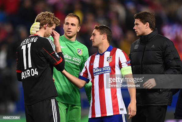 Stephan Kiessling of Bayer Leverkusen is consoled by goalkeeper Jan Oblak and Koke of Atletico Madrid after missing the last penalty in the shoot out...