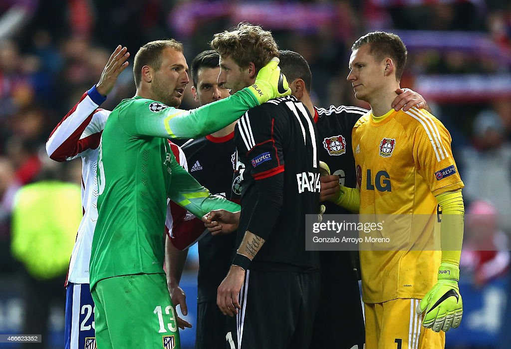 Stephan Kiessling of Bayer Leverkusen is consoled by goalkeeper Jan Oblak of Atletico Madrid after missing the last penalty in the shoot out during the UEFA Champions League round of 16 match between Club Atletico de Madrid and Bayer 04 Leverkusen at Vicente Calderon Stadium on March 17, 2015 in Madrid, Spain.