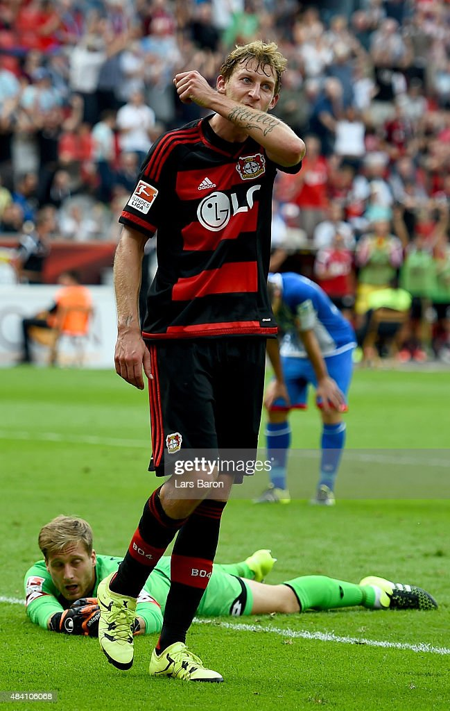 Stephan Kiessling of Leverkusen celebrates with team mates after scoring his teams first goal during the Bundesliga match between Bayer Leverkusen and 1899 Hoffenheim at BayArena on August 15, 2015 in Leverkusen, Germany.