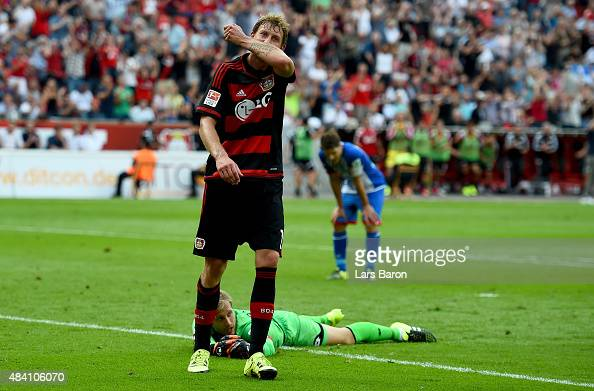 Stephan Kiessling of Leverkusen celebrates with team mates after scoring his teams first goal during the Bundesliga match between Bayer Leverkusen...