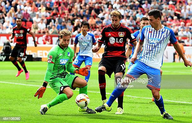 Stephan Kiessling of Leverkusen is challenged by Oliver Baumann and Fabian Schar of Hoffenheim during the Bundesliga match between Bayer Leverkusen...