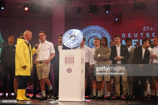 Stephan Lehmann talks to Philipp Lahm during the FC Bayern Muenchen Championship party following the Bundesliga match between Bayern Muenchen and SC...