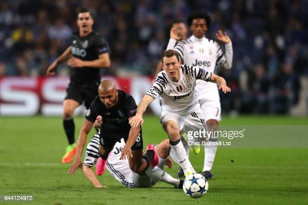 Stephan Lichtsteiner and Andrea Barzagli of Juventus compete with Yacine Brahimi of FC Porto during the UEFA Champions League Round of 16 first leg...