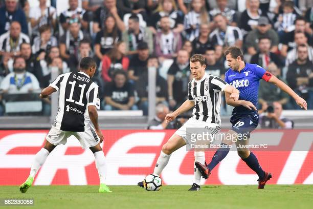 Stephan Lichtsteiner and Senad Lulic during the Serie A match between Juventus and SS Lazio on October 14 2017 in Turin Italy