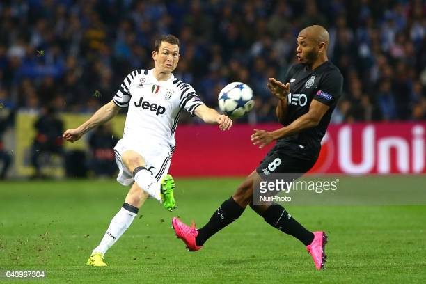 Stephan Lichtsteiner defender of Juventus FC in action with Porto's Algerian forward Yacine Brahimi during the UEFA Champions League Round of 16 1st...