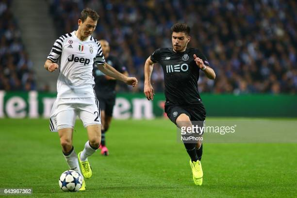 Stephan Lichtsteiner defender of Juventus FC in action with Porto's Portuguese midfielder Ruben Neves during the UEFA Champions League Round of 16...