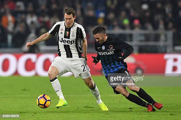 Stephan Lichtsteiner of FC Juventus competes with Marco D Alessandro of Atalanta BC during the TIM Cup match between FC Juventus and Atalanta BC at...