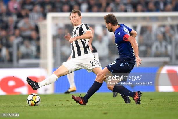 Stephan Lichtsteiner of Juventus and Senad Lulic of Lazio compete for the ball during the Serie A match between Juventus and SS Lazio on October 14...