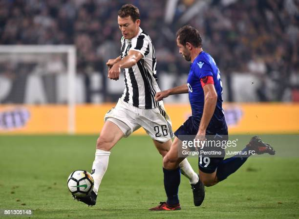 Stephan Lichtsteiner of Juventus and Senad Lulic of Lazio in action during the Serie A match between Juventus and SS Lazio on October 14 2017 in...
