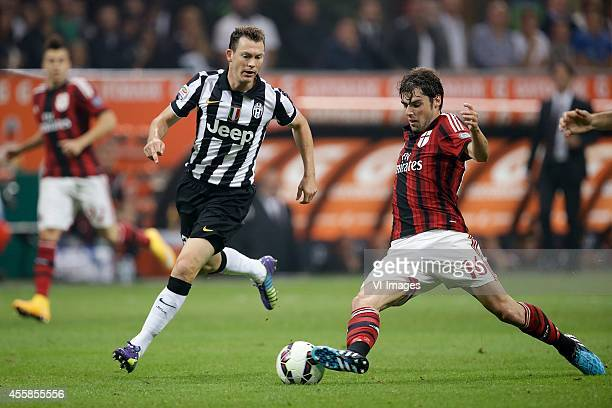 Stephan Lichtsteiner of Juventus Andrea Poli of AC Milan during the Serie A match between AC Milan and Juventus on September 20 2014 at the Stadio...