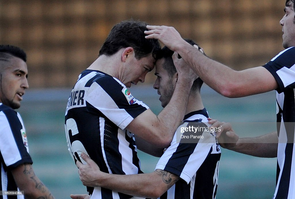 Stephan Lichtsteiner (centre L) of Juventus celebrates after scoring his team's second goal with Sebastian Giovinco during the Serie A match between AC Chievo Verona and Juventus FC at Stadio Marc'Antonio Bentegodi on February 3, 2013 in Verona, Italy.